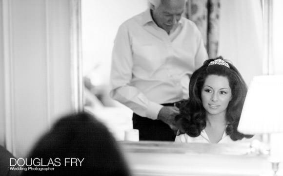 Bride having hair prepared at Dorchester Hotel ready for wedding