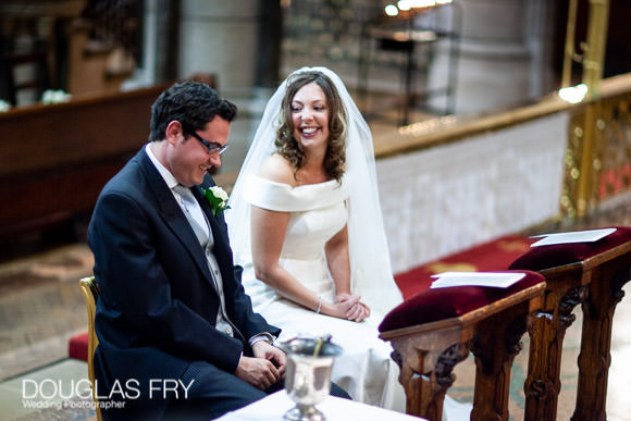 Couple photographed during wedding service in Church