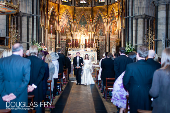wedding photograph of couple walking down aisle in London church - St Columbas