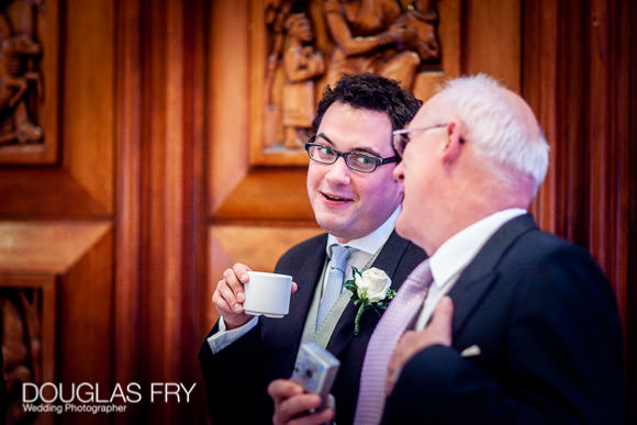 Groom in conversation at wedding at RIBA
