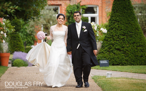 photograph of couple walking in the gardens at the Grove Hotel