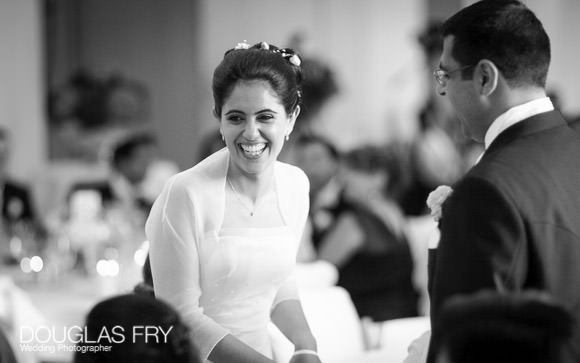 The bride laughing during the wedding reception