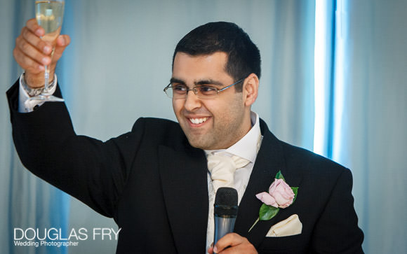 The groom raising a toast during his speeches