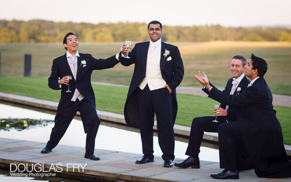 ushers and groom outside at the Grove Hotel