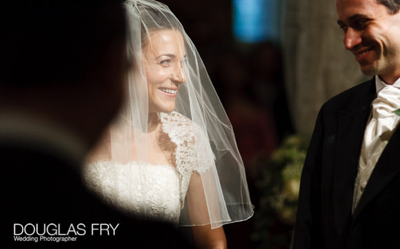 Bride and groom photographed during wedding ceremony in London