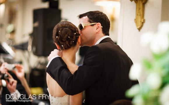 Groom photographed kissing bride at Berekeley Hotel