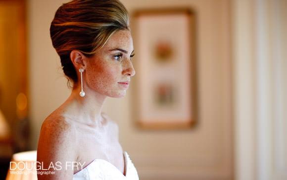 Bride photographed in front of Mandarin Oriental window in London