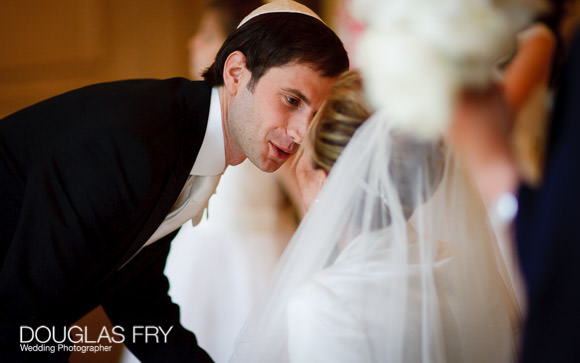 Groom kissing the bride at the Mandarin in London