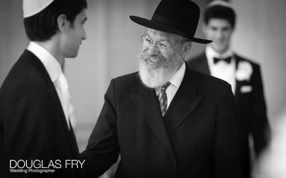 Rabi greeting groom during jewish wedding in London