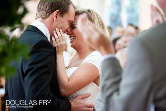 Applause during wedding vows photographed by Douglas Fry