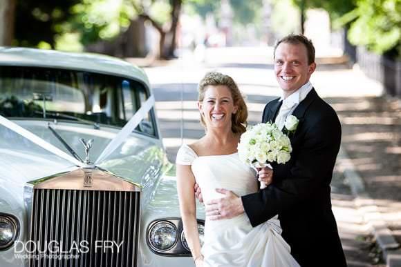 Ranelagh Gardens Wedding Photograph of bride and groom with car