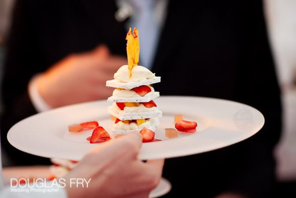 Photograph of desert at wedding reception in London with strawberries and merinque