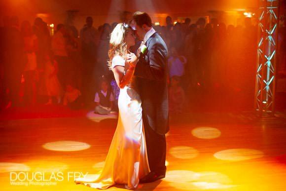 Wedding photograph of bride and groom dancing