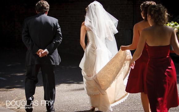 Bride entering HTB for wedding service in London