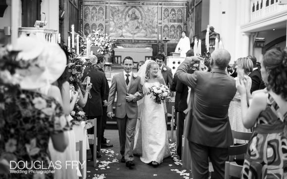 wedding photograph of couple leaving the church in London