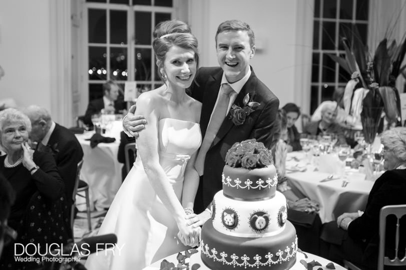 Wedding Photographer Queens House - Greenwich - cake cutting