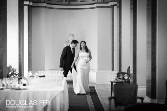 Couple enter reception - black and white wedding photograph