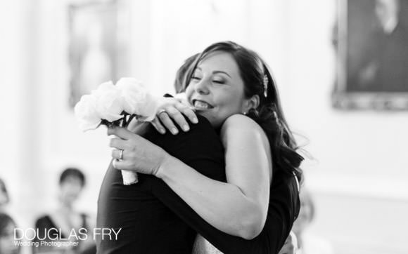 Bride and groom embrace at end of ceremony