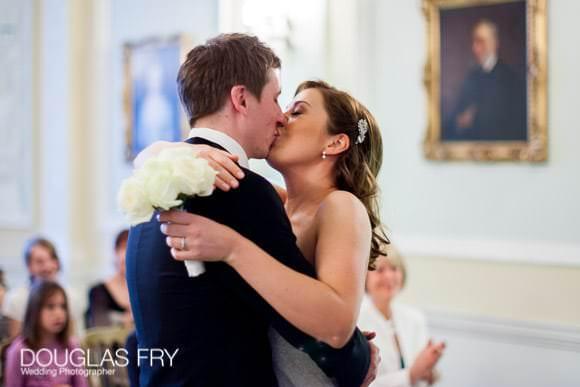 Bride and groom kissing at Lansdowne Club in London