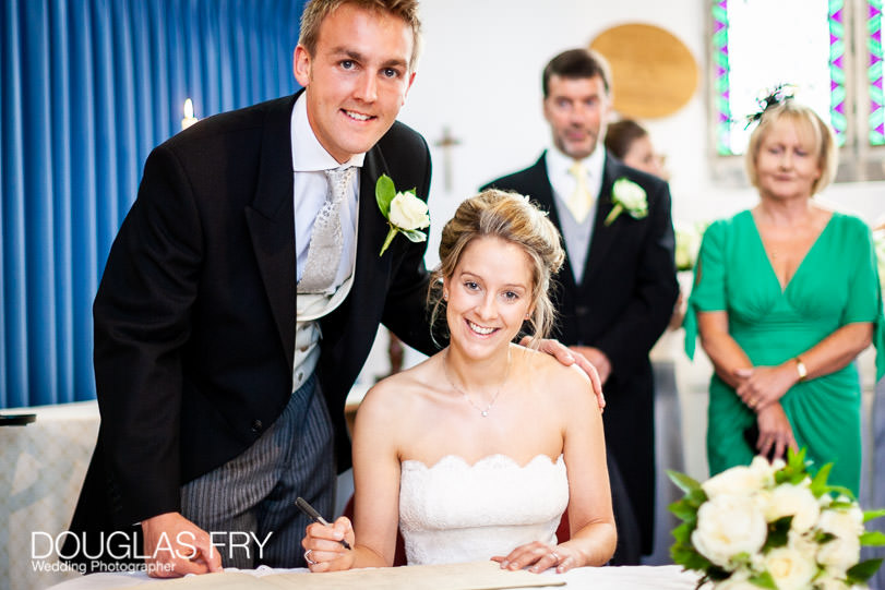 signing the register wedding photograph