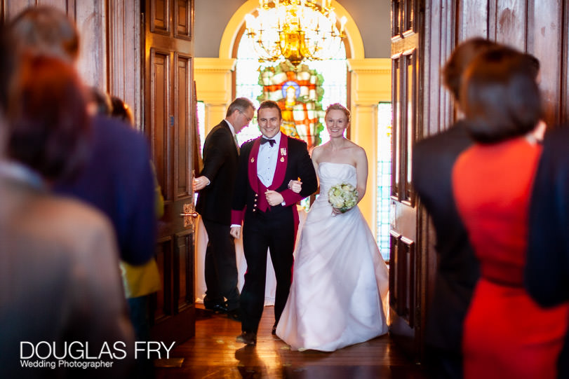 Bride and groom entering dinner at HAC on wedding day