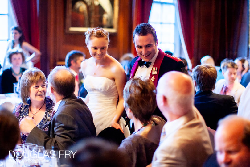 bride and groom speaking to guest during wedding