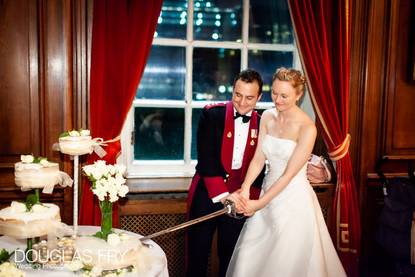 cutting wedding cake photographed at HAC in London