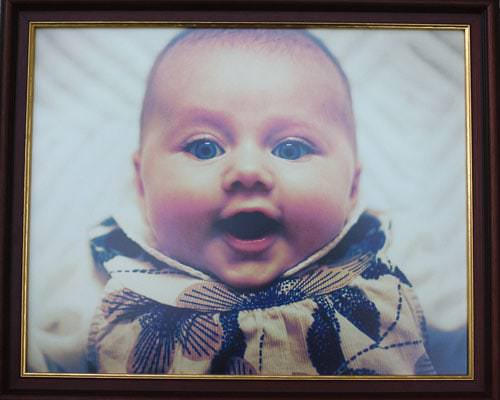 framed baby portrait photograph of baby Mia