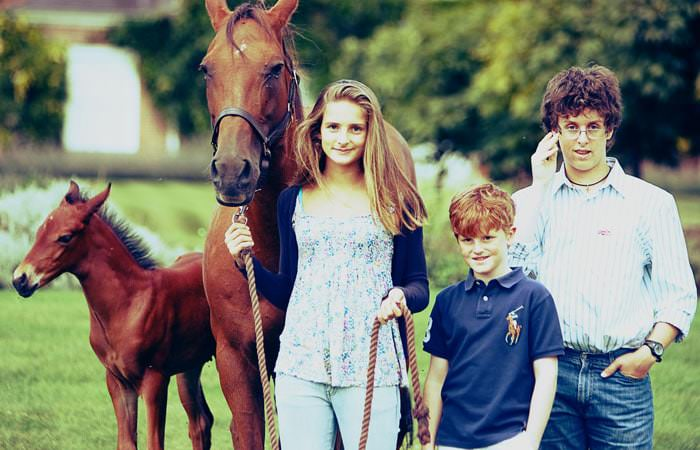 Family photographs of the children at home with mare and foal 1