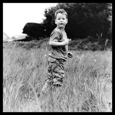 black and white portrait photograph of Edmund in field Hasselblad