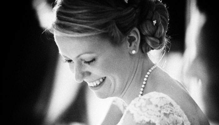 Black and white wedding photograph of bride at dinner at Bingham Hotel, Richmond
