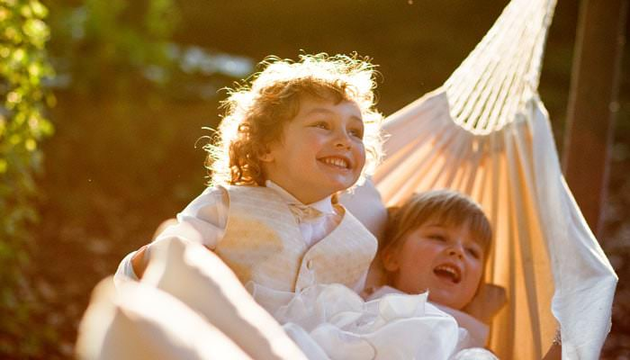 Bridesmaid and page boy photographed in hammock at wedding in Richmond