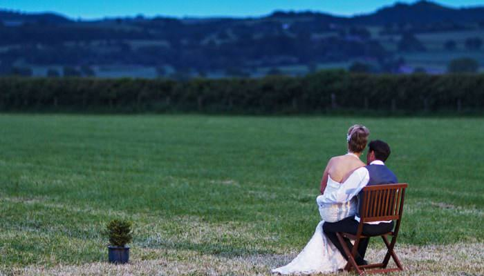 Wedding Photograph of Bride and Groom admiring the Shropshire view at end of wedding