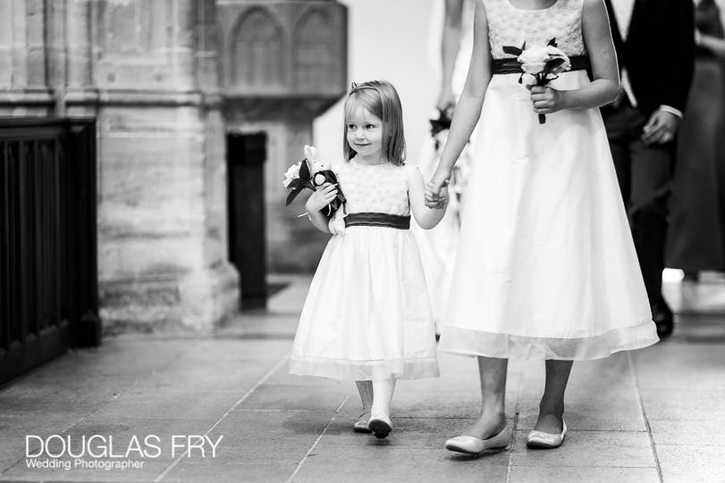 Bridesmaids arriving at Sherborne Abbey in Dorset for wedding
