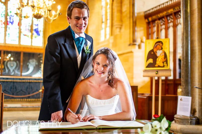 Wedding Photographer - Dorset - signing the register in Sherborne Abbey