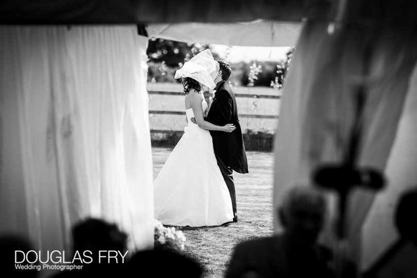 Bride and groom outside marquee during Dorset wedding