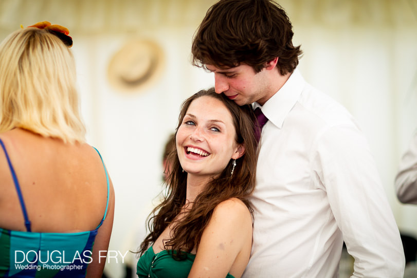 Guests photographed during Dorset wedding reception in marquee
