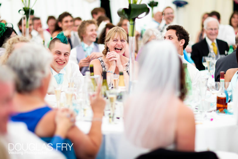 speaches - laughter in marquee during wedding in countryside
