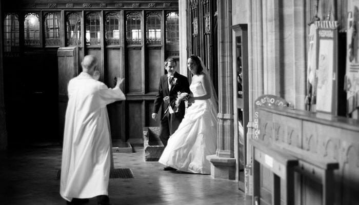 Wedding photograph in black and white of Rosie and Mark in Sherborne Abbey after the service