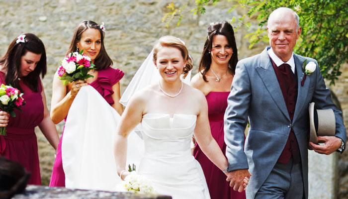 Wedding photograph of bride arriving at Bladon Church, Oxfordshire