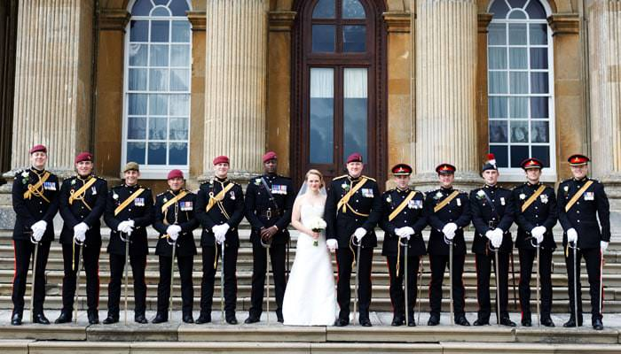 Wedding photograph of bride and groom with regiment at Blenheim Palace, Oxfordshire