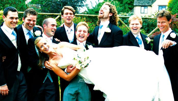 Wedding Photographer - Rachel and Tommy plus ushers in Garden in Kemble