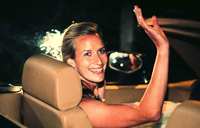 Wedding Photographer - Rachel leaving in car in Kemble