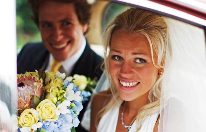 Wedding photograph of Joss and Jono in Wedding Car