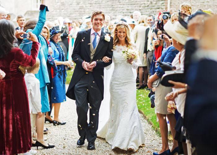 Wedding Photograph of bride and groom at Kemble church