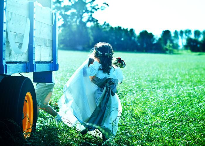 Atmospheric Wedding Photograph of bridesmaid in Field - Kemble, Gloucestershire