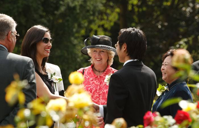 Wedding Photograph at guests outside in the gardens at the Belvedere, Holland Park, London