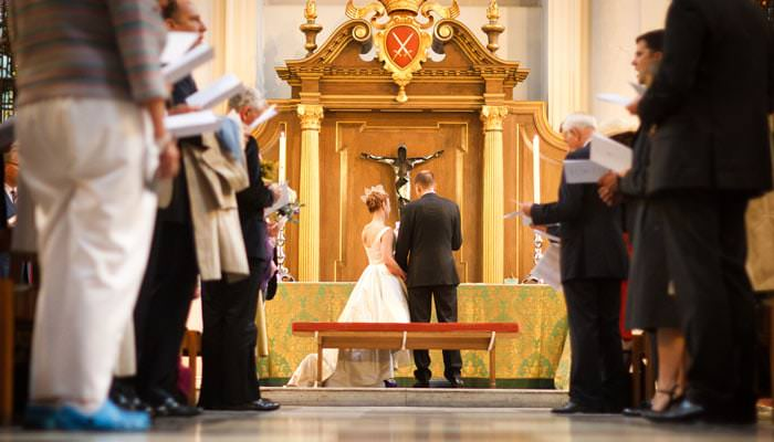 Wedding photograph of bride and groom at St Mary Le Bow Church, London