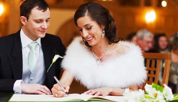 Wedding Photograph Signing the Register at Rivervale Barn Hampshire