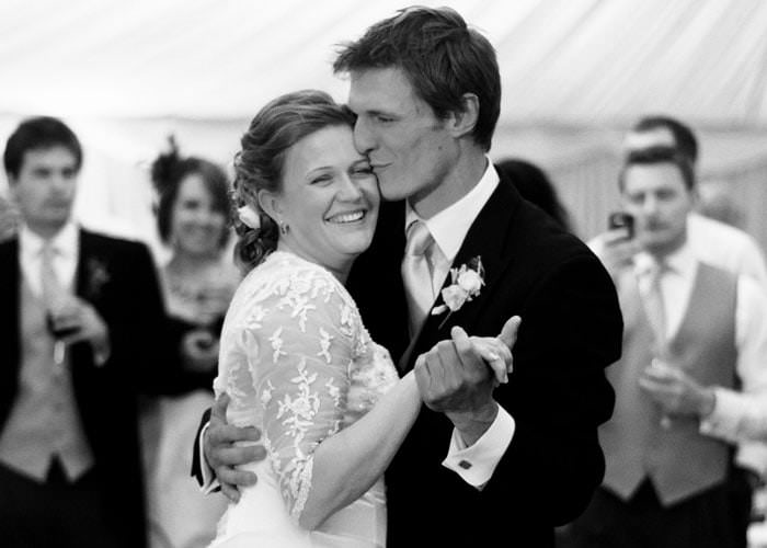 Wedding Photograph of Bride and Groom Dancing in Black and White